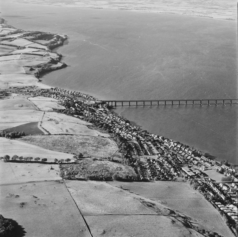 General oblique aerial view of the towns and the S end of the Tay Bridge, taken from the E.
