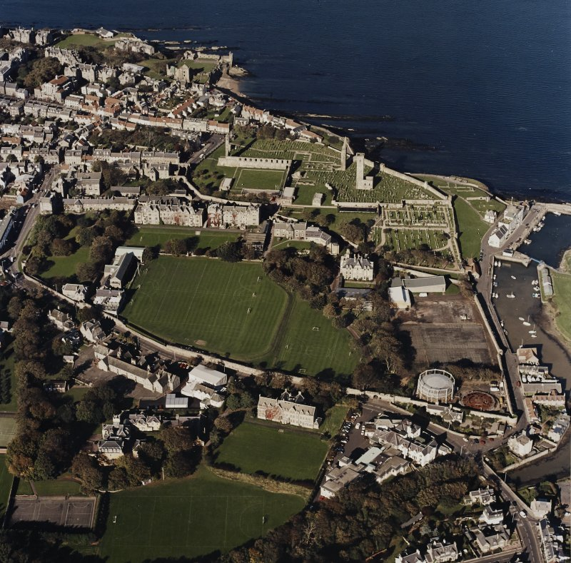 Oblique aerial view of St Andrews centred on the cathedral with castle adjacent, taken from the S.