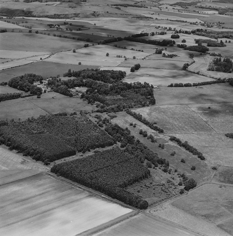 General oblique aerial view looking across the policies of the country house, taken from the SW.