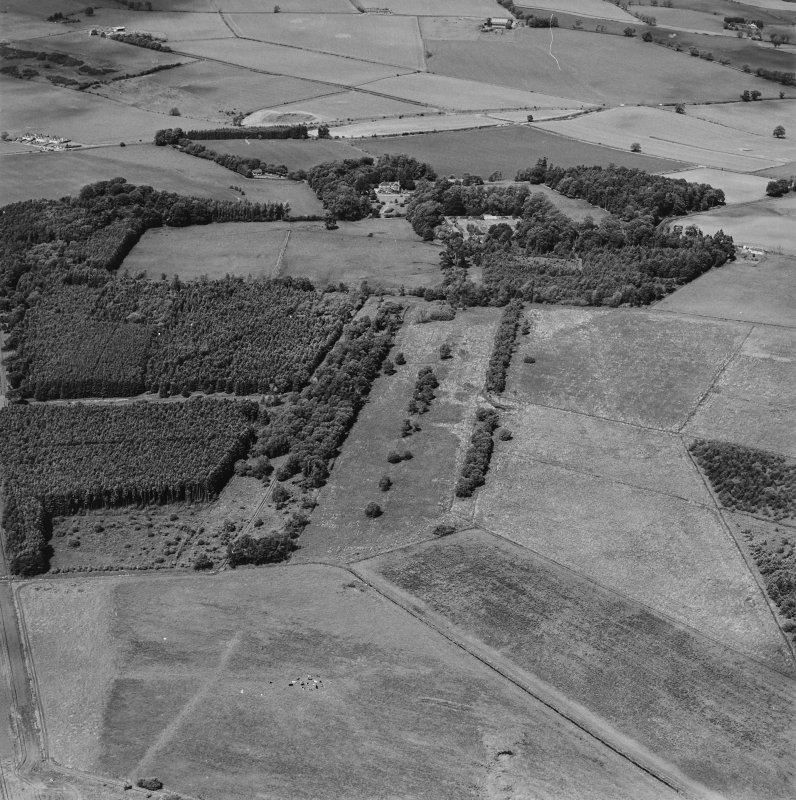 General oblique aerial view looking across the policies of the country house, taken from the S.