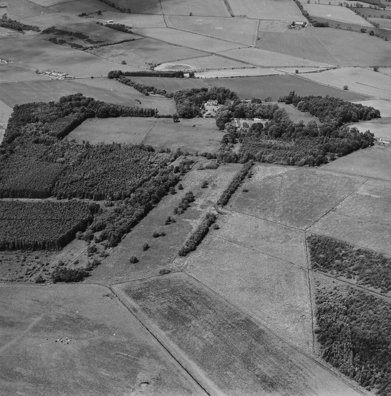 General oblique aerial view looking across the policies of the country house, taken from the SE.