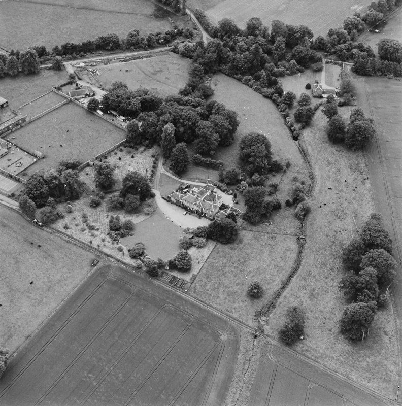 Oblique aerial photograph of Lathrisk House centred on a country house. Lathrisk Laundry house is situated to the N, in the top right of the photograph. Taken from the NE.