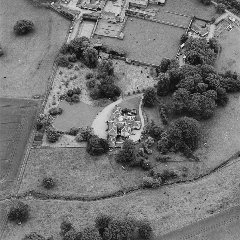 Oblique aerial photograph of Lathrisk House centred on a country house. Lathrisk Home Farm is situated to the S, in the top centre of the photograph.  Taken from the N.