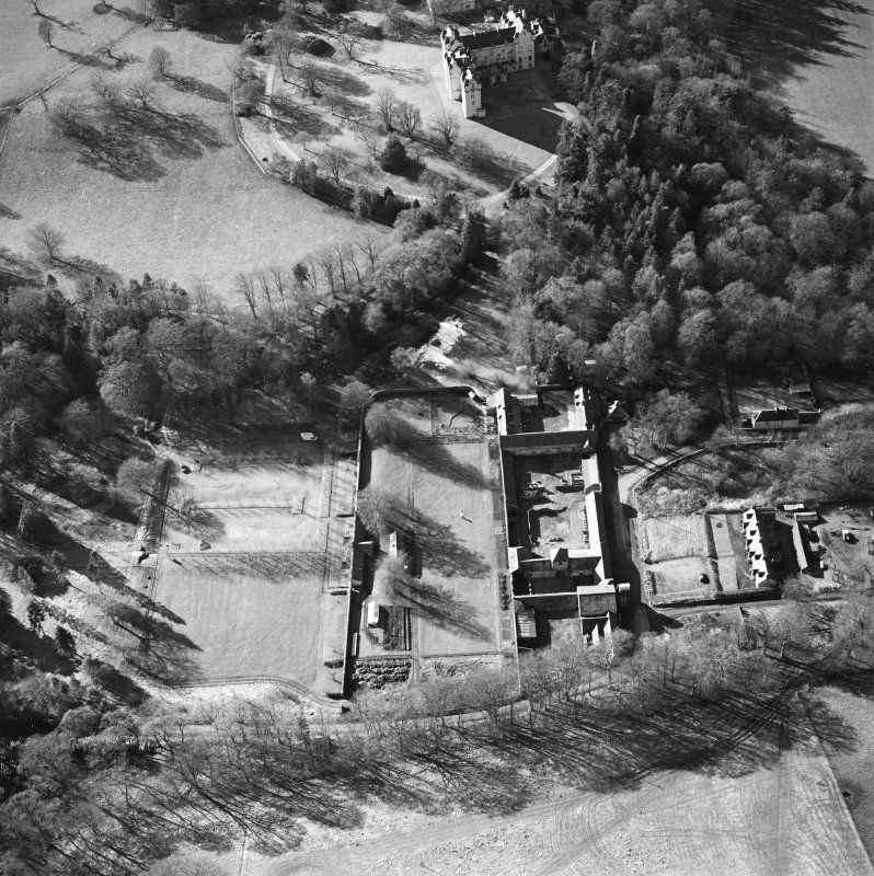 Oblique aerial view centred on the walled garden and farmsteading with castle adjacent, taken from the E.