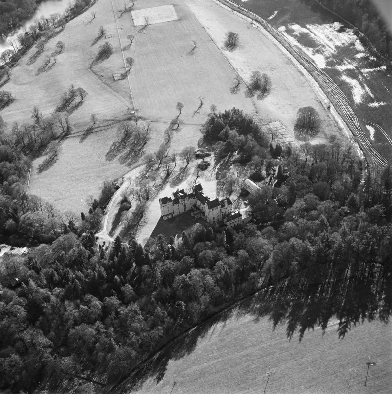 Oblique aerial view centred on the castle taken from the NE.