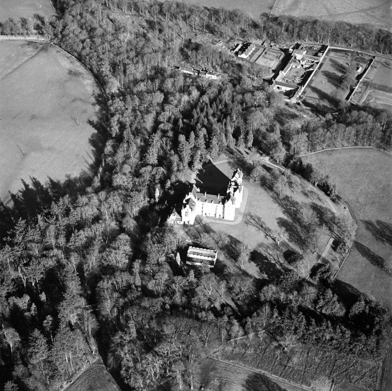 Oblique aerial view centred on the castle with walled garden and farmsteading adjacent, taken from the WSW.