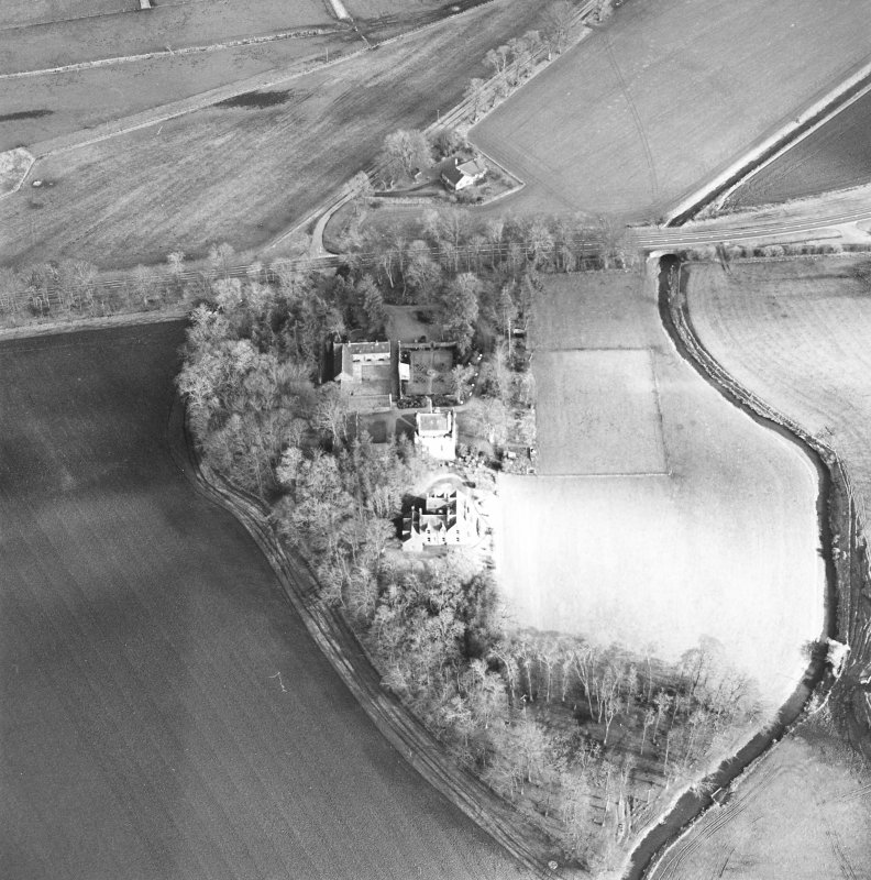 Oblique aerial view centred on the castle and tower-house, taken from the WNW.