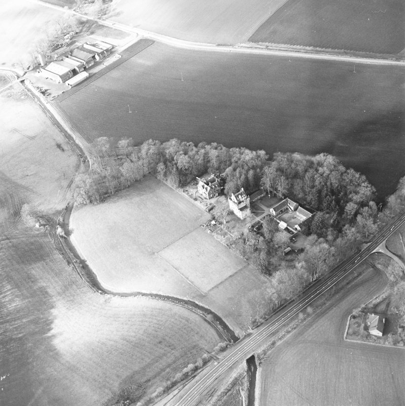 Oblique aerial view centred on the castle and tower-house, taken from the SE.