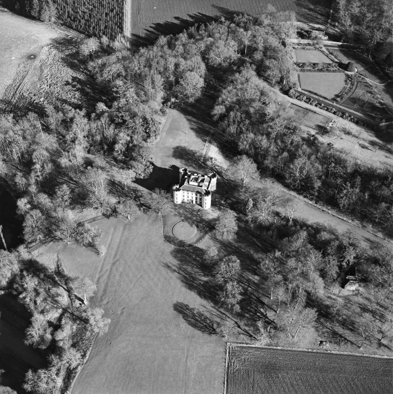 Oblique aerial view centred on the castle and tower-house, taken from the W.
