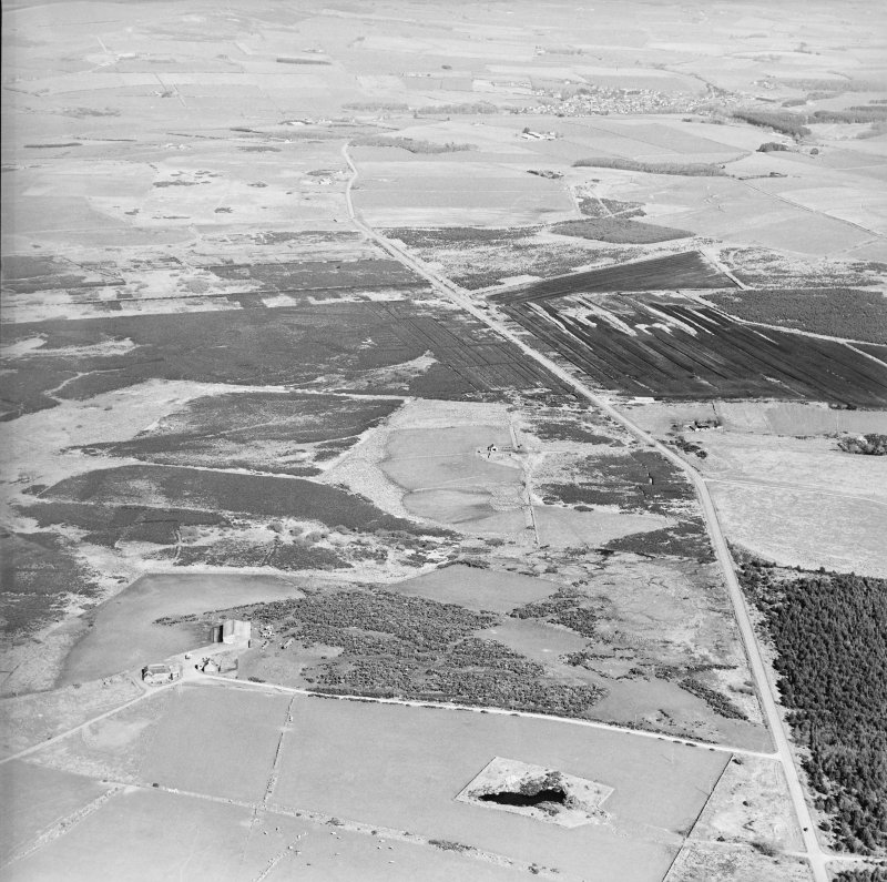 General aerial oblique view of farmsteads and quarry, taken from the WNW.