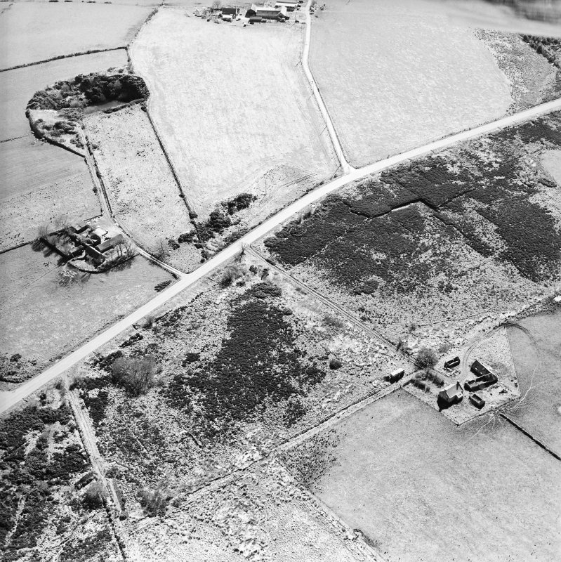 Oblique aerial view centred on the farmsteads, taken from the NE.