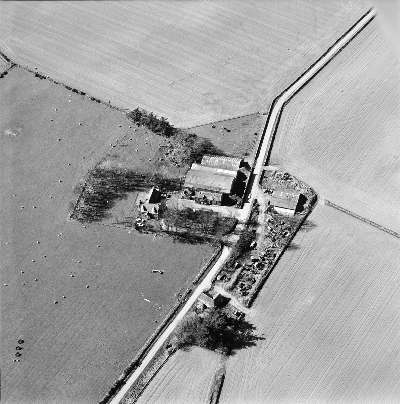 Oblique aerial view centred on the remains of the abbey and the house, farmhouse and farmsteading, taken from the NE.