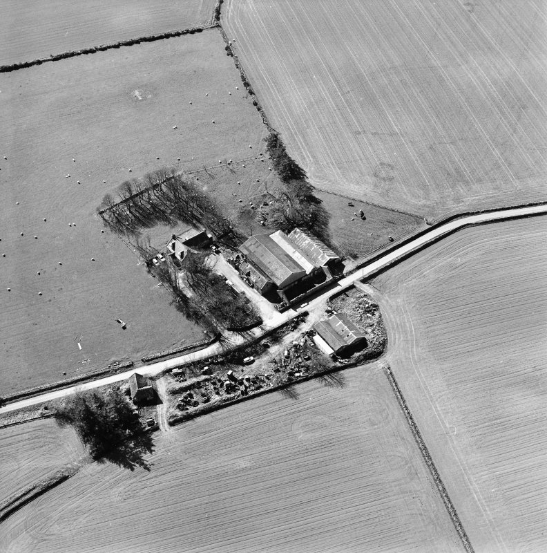 Oblique aerial view centred on the remains of the abbey and the house, taken from the NNW.