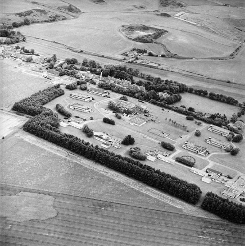 General oblique aerial view of the hospital and the railway station, taken from the NW.
