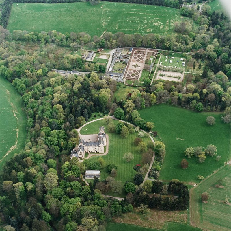 Oblique aerial view centred on Fyvie Castle with walled garden adjacent, taken from the W.