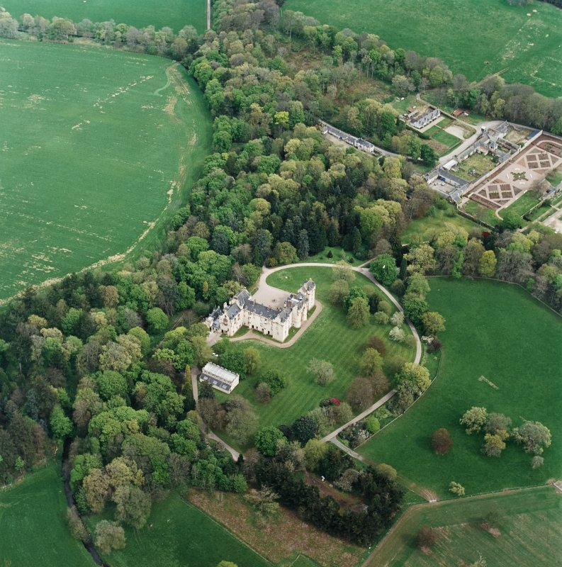 Oblique aerial view centred on Fyvie Castle with walled garden adjacent, taken from the WSW.