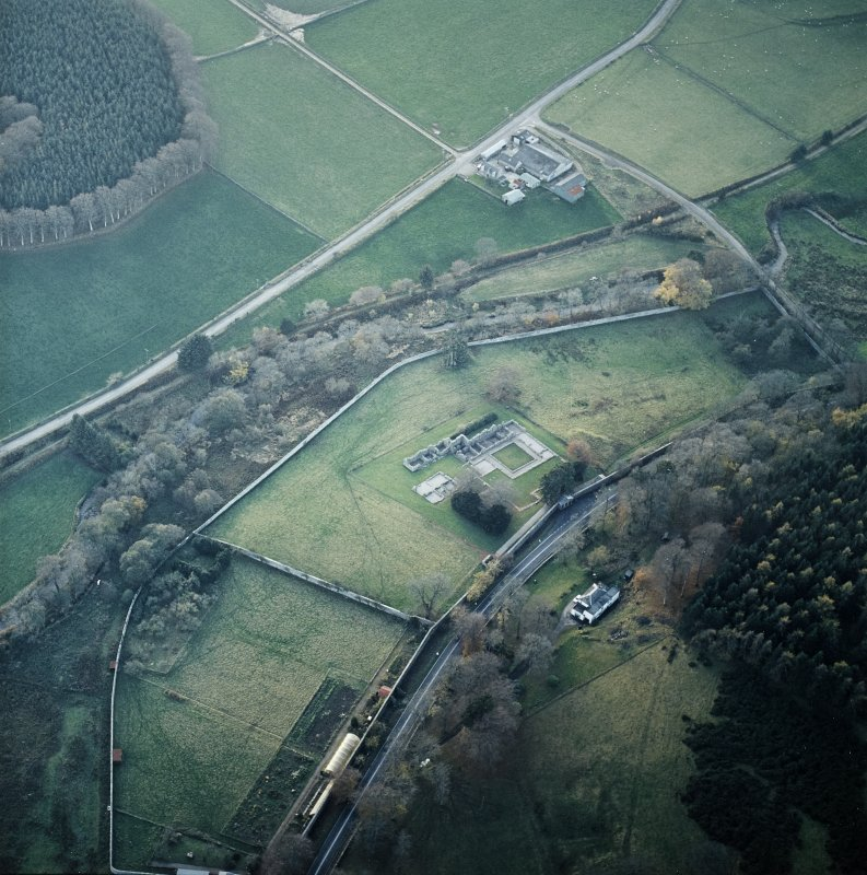 Oblique aerial view centred on the remains of the abbey with the walled garden, house and farmsteading adjacent, taken from the NE.