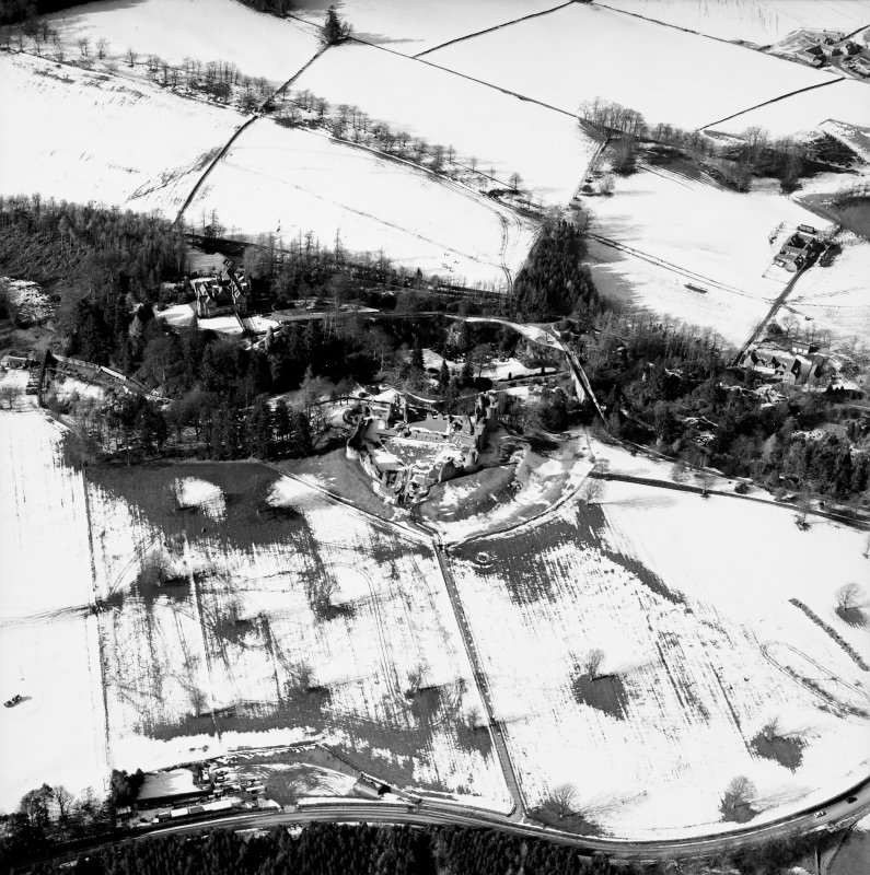 Oblique aerial photograph, taken from the SE, centred on Kildrummy Castle.