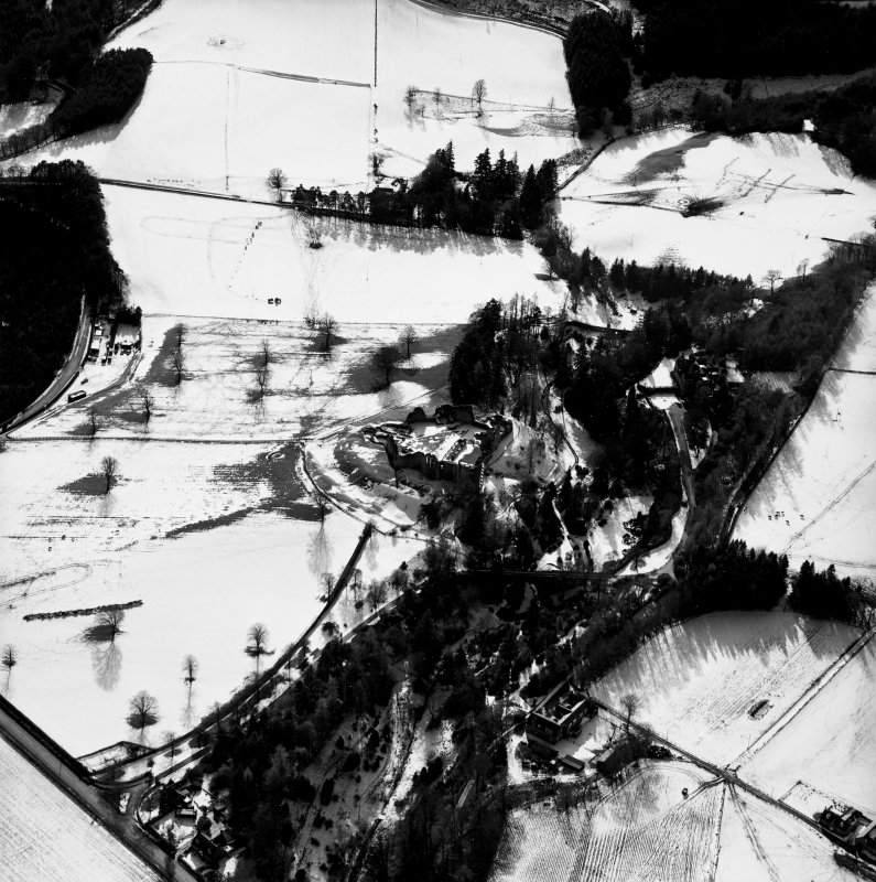 Oblique aerial photograph, taken from the NNE, centred on Kildrummy Castle.