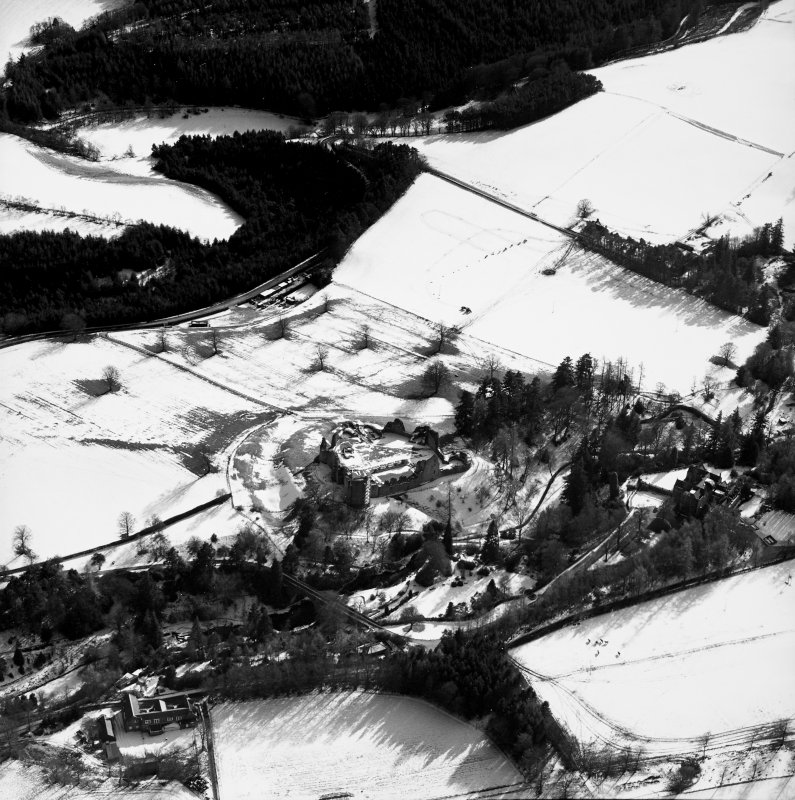 Oblique aerial photograph, taken from the N, centred on Kildrummy Castle.