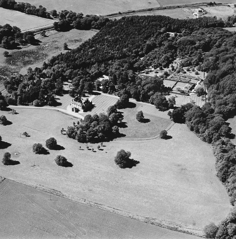 Oblique aerial view of Leith Hall centred on the country house and walled garden, taken from the E.