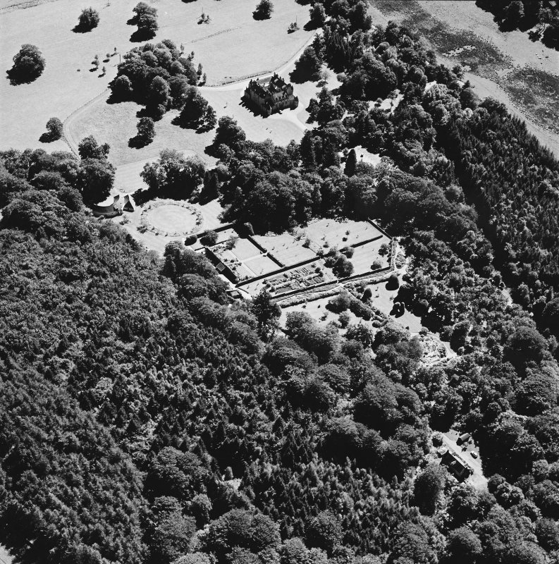 Oblique aerial view of Leith Hall centred on the country house, walled garden and offices, taken from the NW.