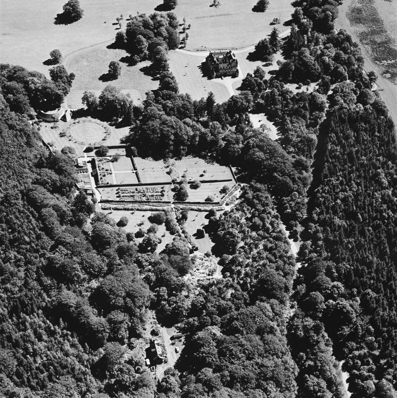 Oblique aerial view of Leith Hall centred on the country house, walled garden and offices, taken from the WNW.
