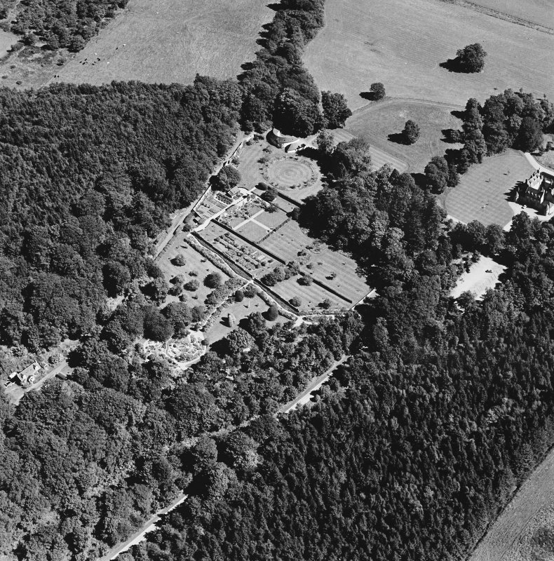 Oblique aerial view of Leith Hall centred on the country house, walled garden and offices, taken from the SW.