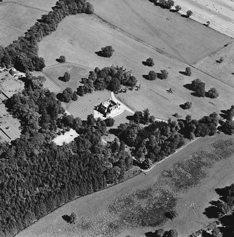 Oblique aerial view of Leith Hall centred on the country house and offices, taken from the SW.