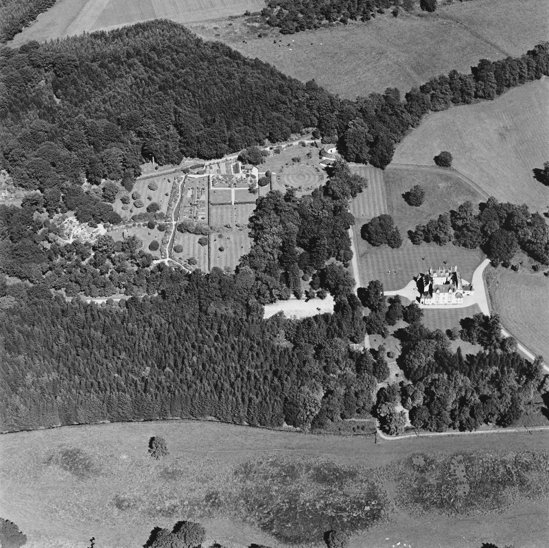 Oblique aerial view of Leith Hall centred on the country house, walled garden and offices, taken from the SSW.