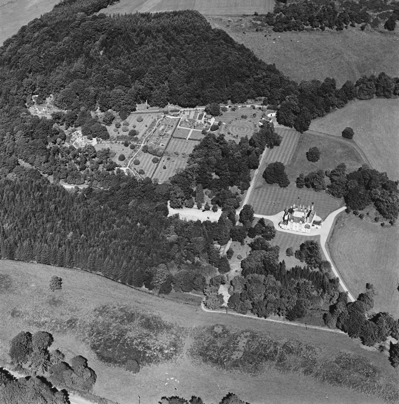 Oblique aerial view of Leith Hall centred on the country house, walled garden and offices, taken from the S.