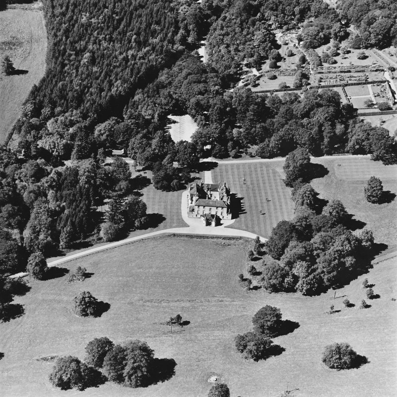 Oblique aerial view of Leith Hall centred on the country house, walled garden and offices, taken from the ESE.