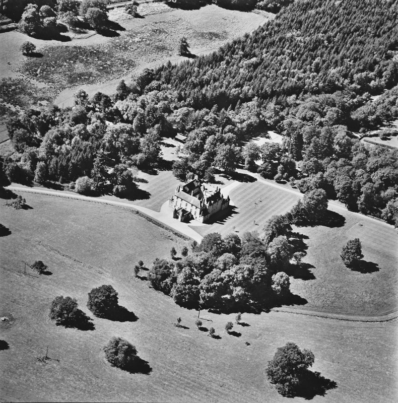 Oblique aerial view of Leith Hall centred on the country house, taken from the NE.