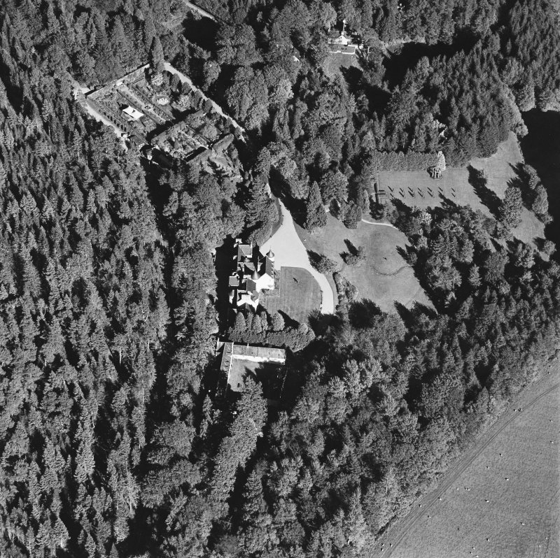 Oblique aerial view of Candacraig House and grounds centred on the country house, taken from the WSW.