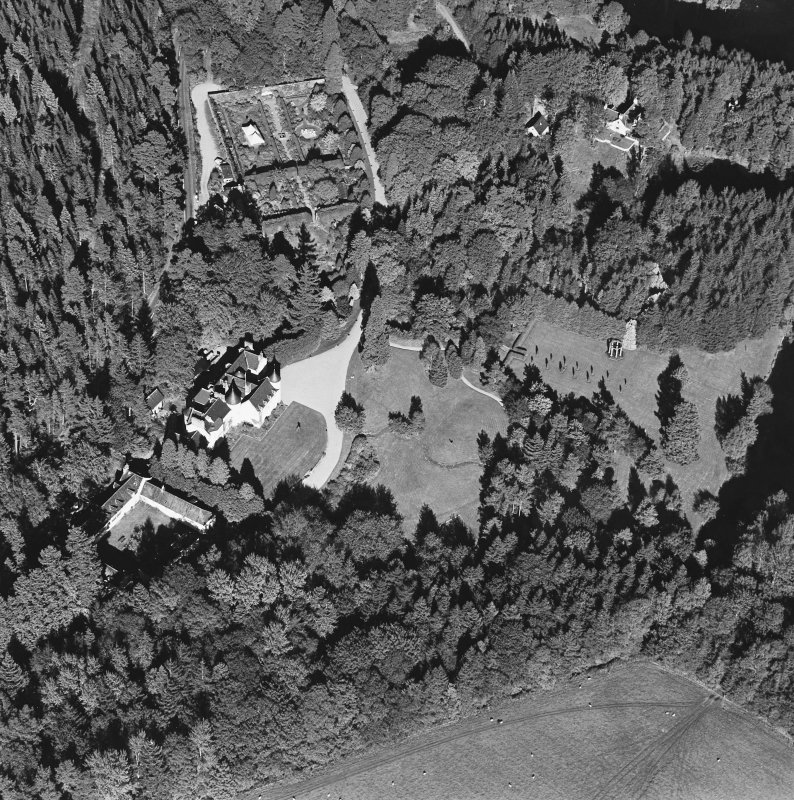 Oblique aerial view of Candacraig House and grounds centred on the country house, taken from the SW.