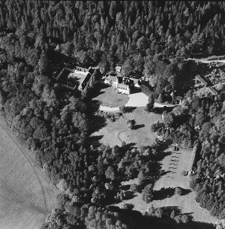 Oblique aerial view of Candacraig House and grounds centred on the country house, taken from the SE.