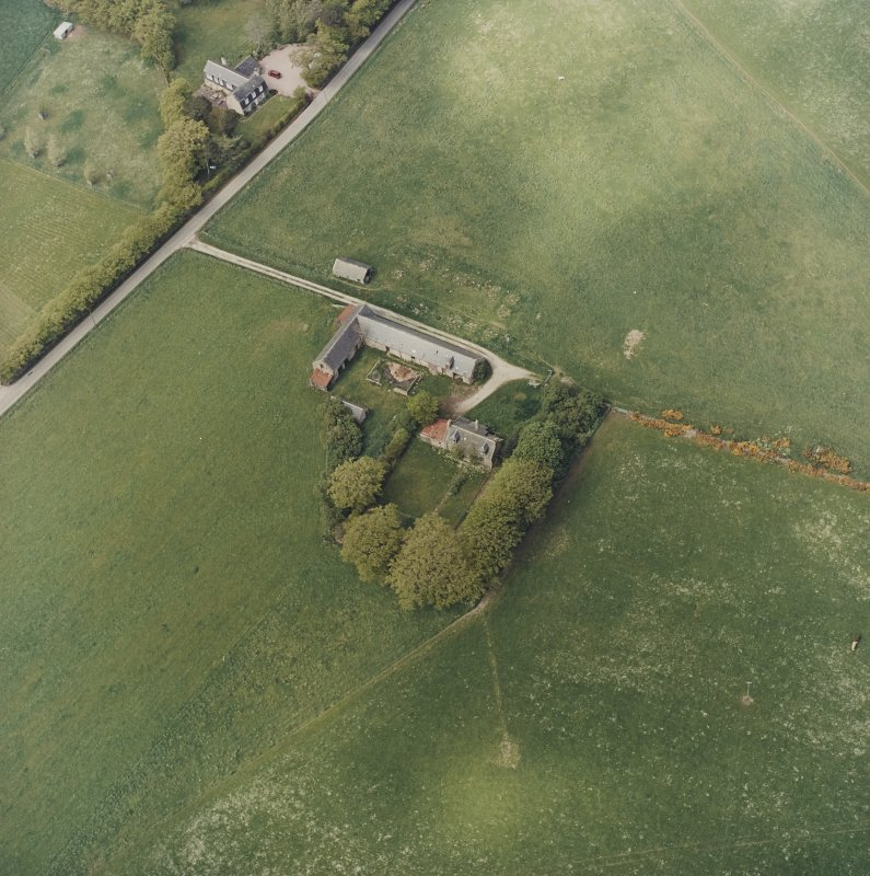 Oblique aerial view of the farmsteading, taken from the SE
