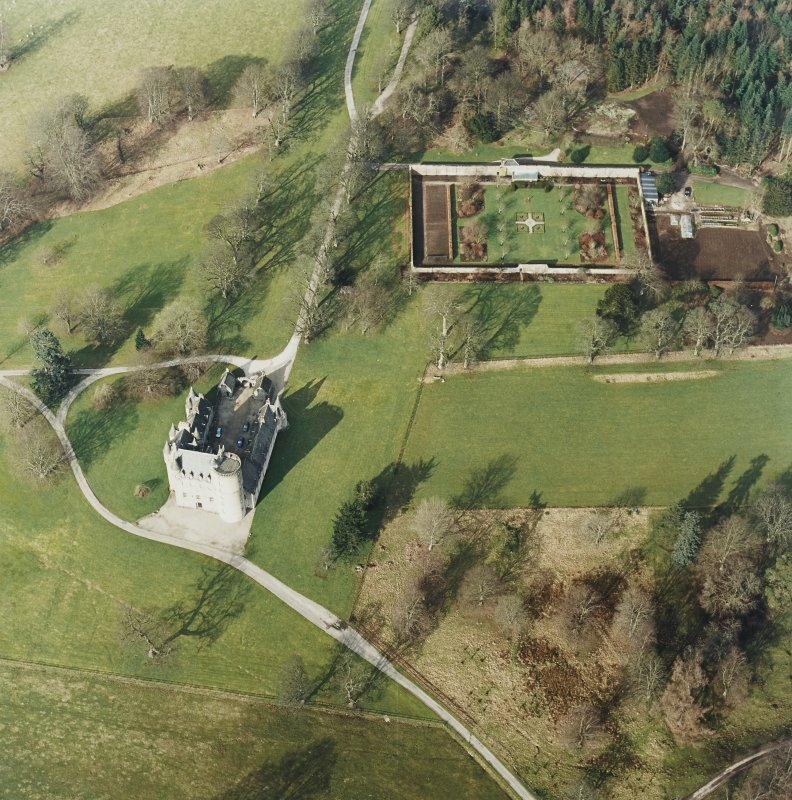 Oblique aerial view of the tower-house with walled garden adjacent, taken from the SSE.