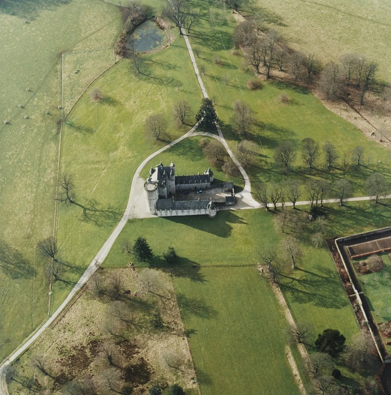 Oblique aerial view centred on the tower-house, taken from the E.