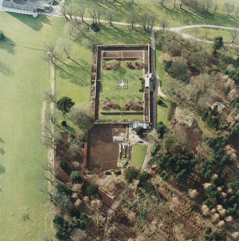 Oblique aerial view centred on the walled garden, taken from the ENE.