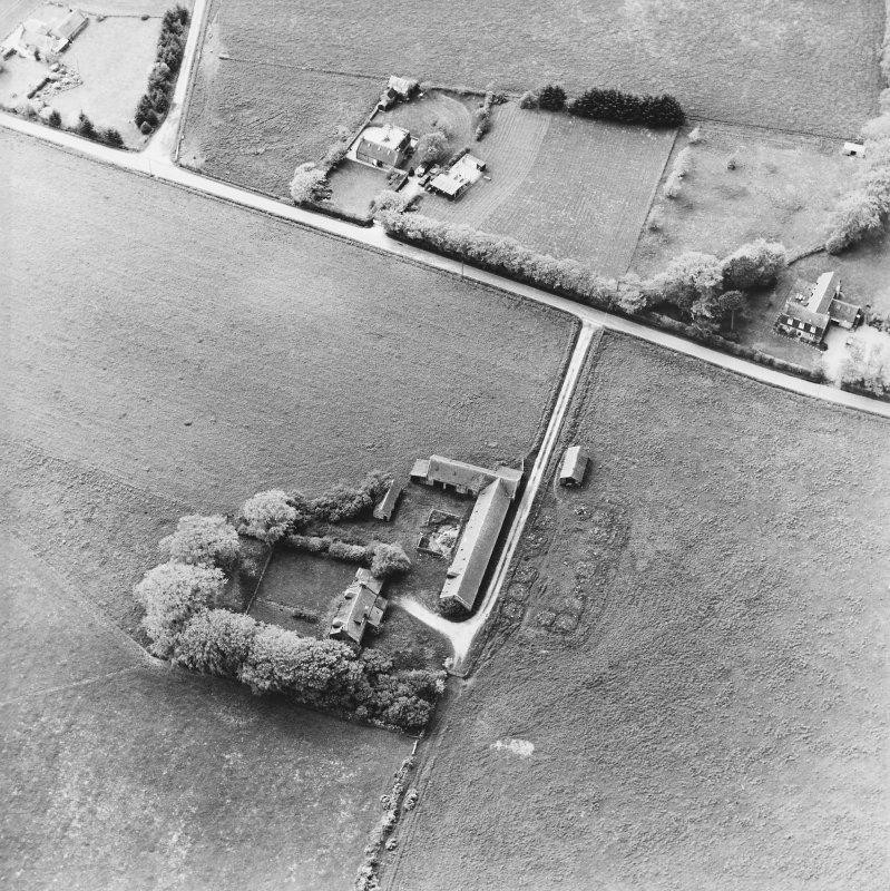 Oblique aerial view of the farmsteadings, taken from the ENE