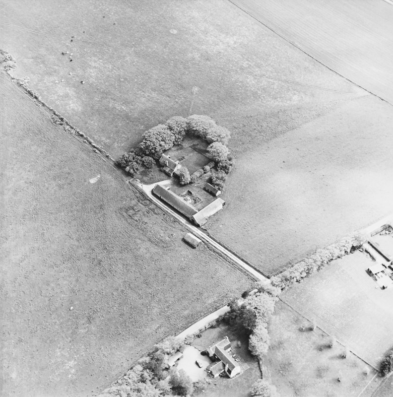 Oblique aerial view of the farmsteading, taken from the NW
