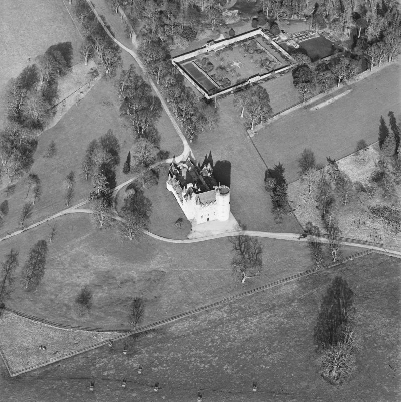 Oblique aerial view of the tower-house with walled garden adjacent, taken from the SSW.