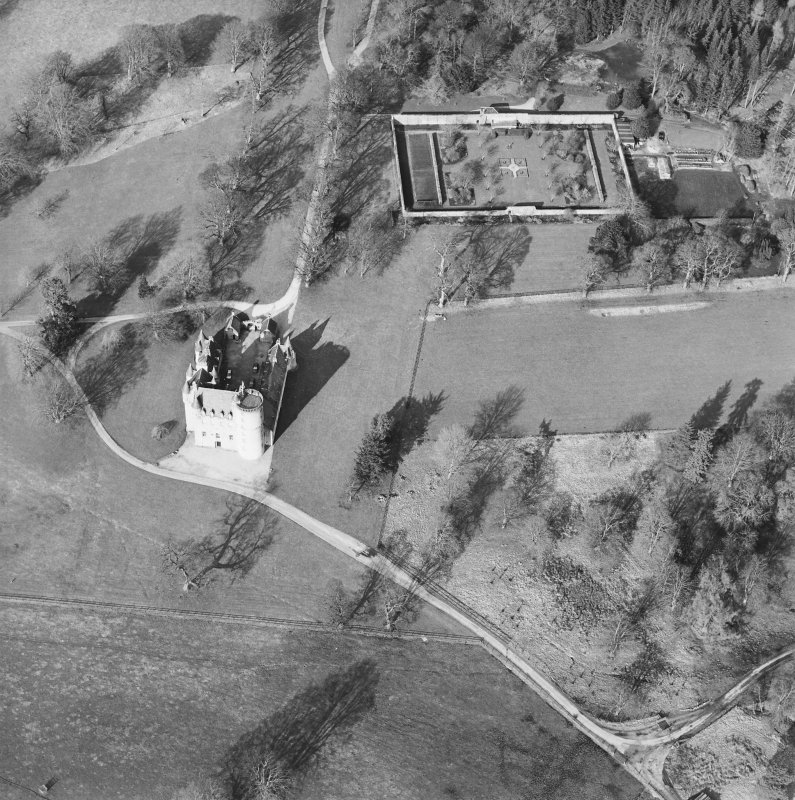 Oblique aerial view of the tower-house with walled garden adjacent, taken from the S.