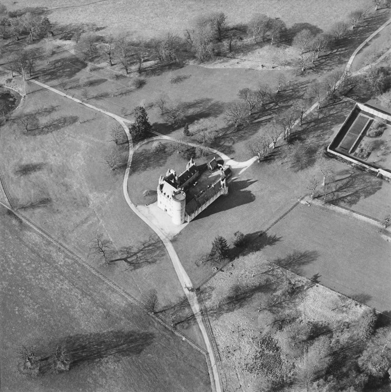 Oblique aerial view of the tower-house, taken from the SE.