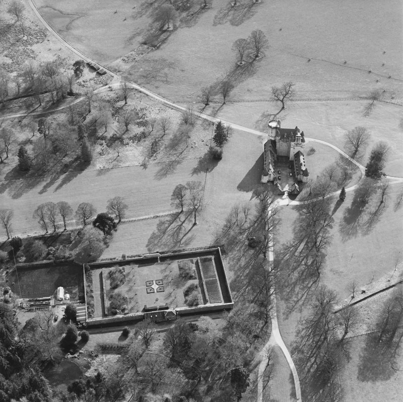 Oblique aerial view of the tower-house with walled garden adjacent, taken from the N.