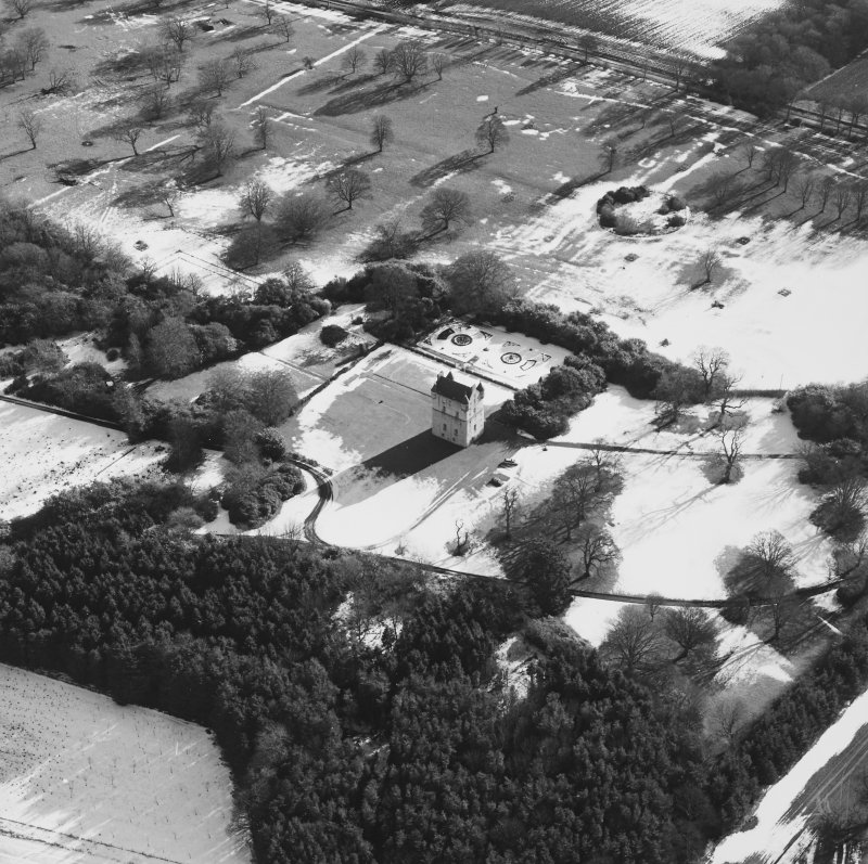 Oblique aerial view centred on Udny Castle and gardens taken from the NW.
