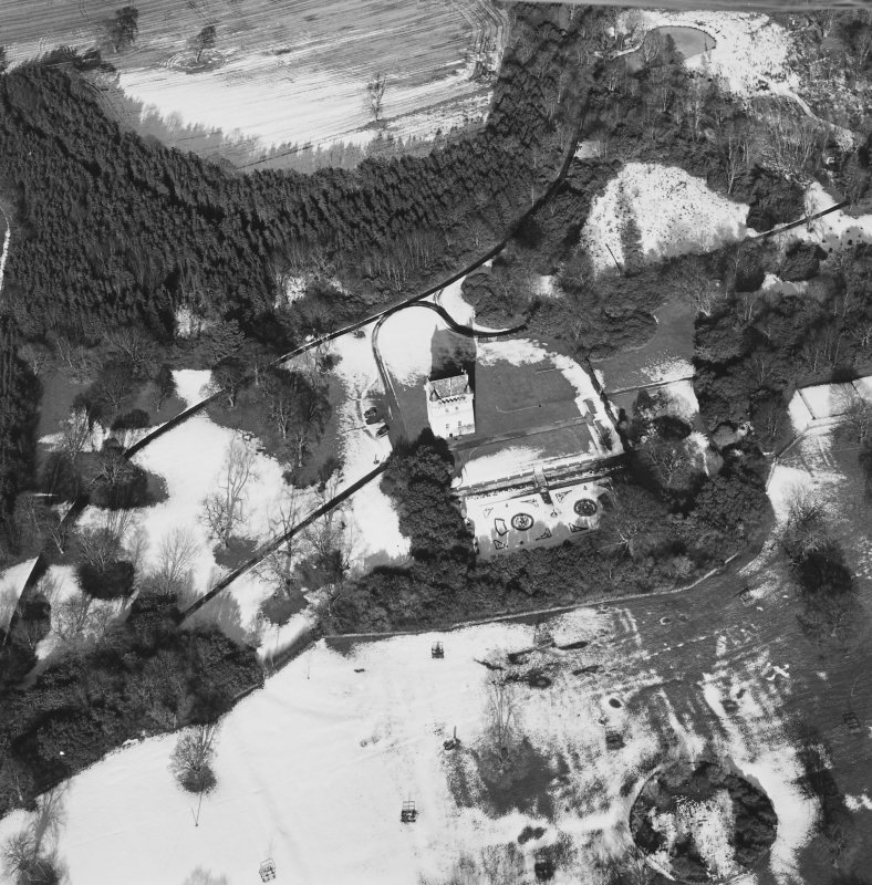 Oblique aerial view centred on Udny Castle and gardens taken from the S.