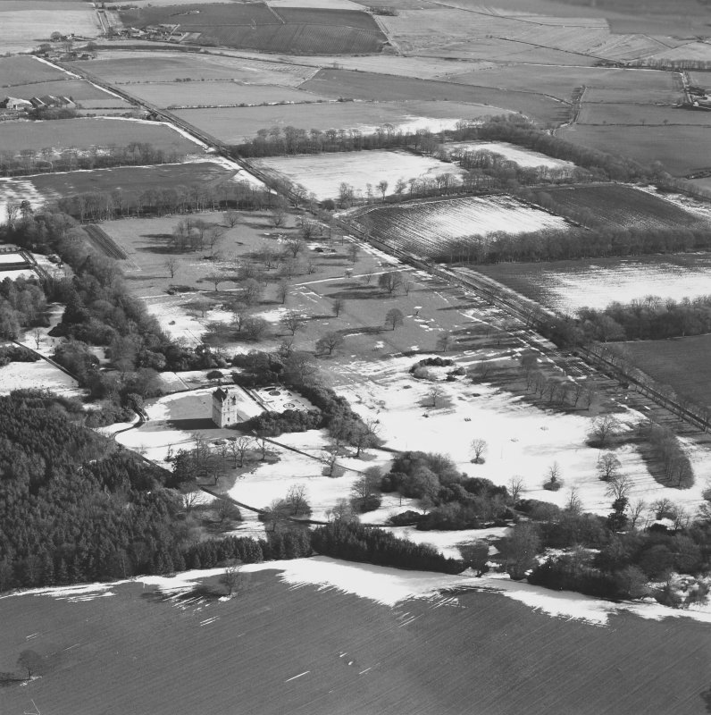 Oblique aerial view centred on Udny Castle and gardens taken from the WNW.