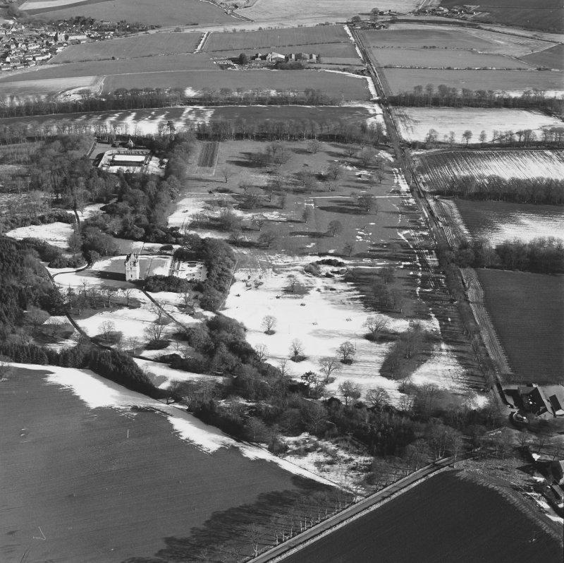 Oblique aerial view centred on Udny Castle and gardens taken from the WSW.